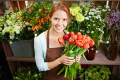 pretty florist holding a bunch of tulips